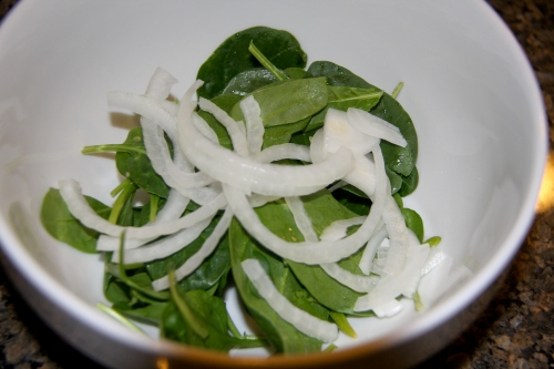 Put Raw Sliced Onions and Spinach Into Bowls